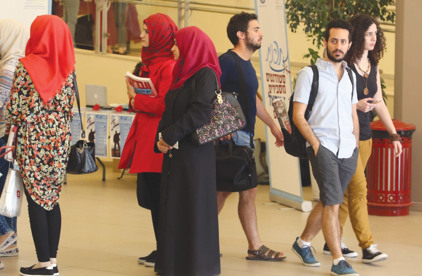 Muslim students are shown in this illustrative photo wearing hijabs at Hebrew University in Jerusalem. (photo credit: MARC ISRAEL SELLEM/THE JERUSALEM POST)