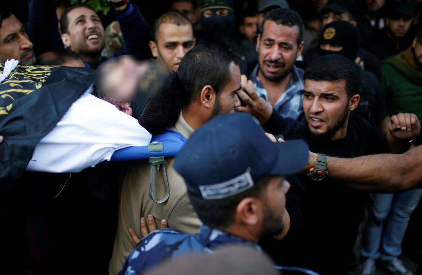 Mourners carry the body of a Palestinian Islamic Jihad militant during his funeral in the central Gaza Strip October 31, 2017 (photo credit: REUTERS)