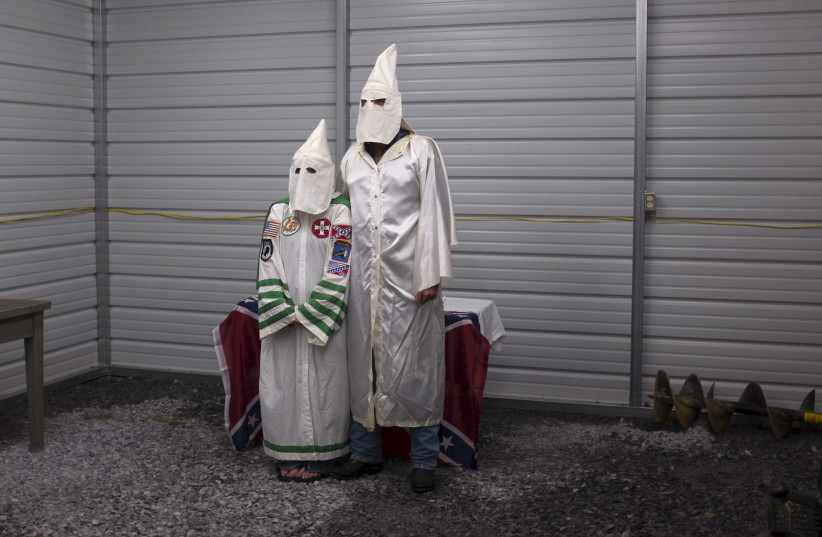 A female and male member of the Virgil Griffin White Knights, a group that claims affiliation with the Ku Klux Klan. (photo credit: REUTERS)