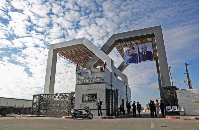 Hamas hands over control of the Rafa border crossing with Egypt to the Palestinian Authority (photo credit: SAID KHATIB / AFP)