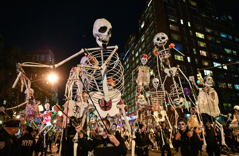 Halloween revelers attend the 44th Annual Village Halloween Parade on October 31, 2017 in New York City (photo credit: DIA DIPASUPIL / GETTY IMAGES NORTH AMERICA / AFP)