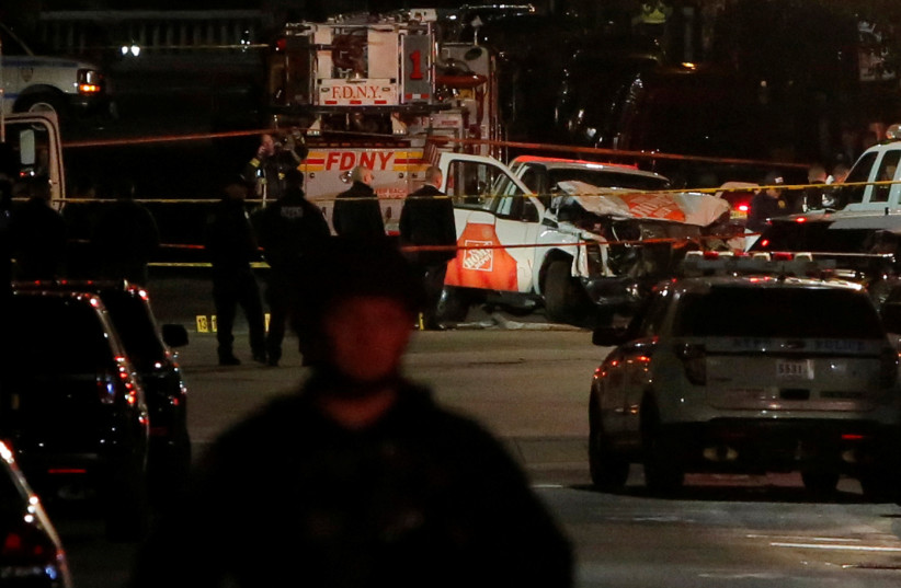 A pickup truck used in an attack sits on the intersection of West and Chambers Street in Manhattan, New York, US, October 31 2017. (photo credit: REUTERS)