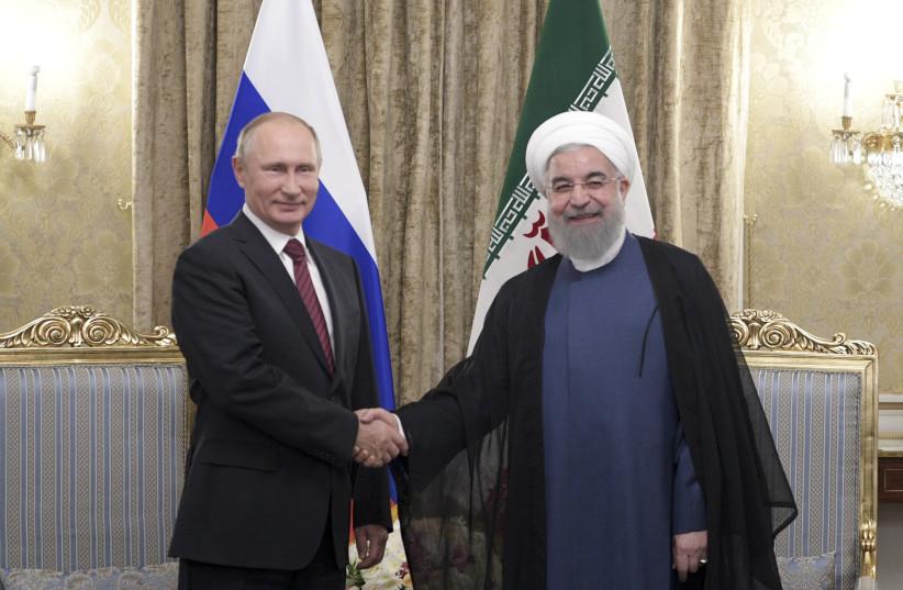 Russian President Vladimir Putin (L) shakes hands with his Iranian counterpart Hassan Rouhani during a meeting in Tehran, Iran November 1, 2017. (photo credit: SPUTNIK/ALEXEI NIKOLSKY/KREMLIN VIA REUTERS)