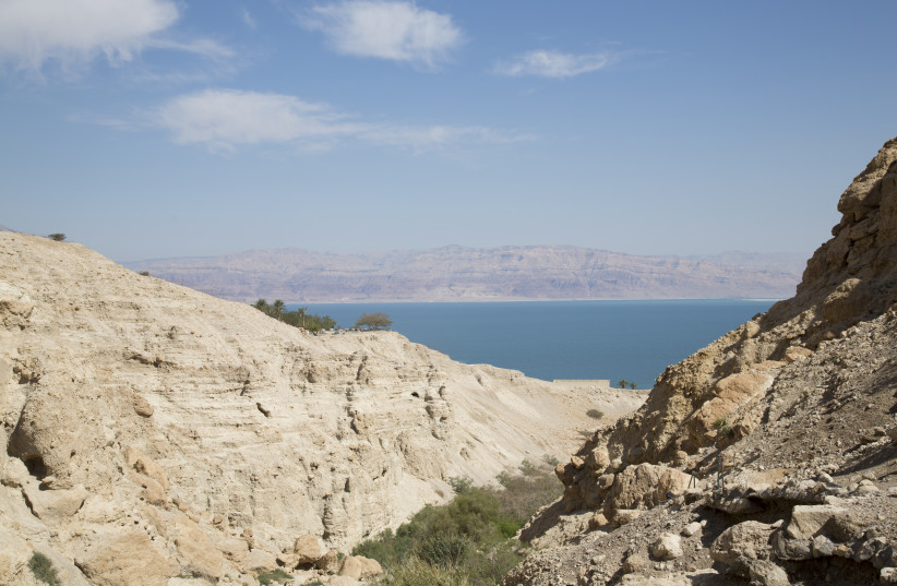 A desert canyon leads in to the Dead Sea  (photo credit: ARIK BAREL)