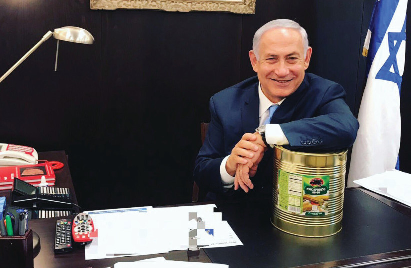 PRIME MINISTER Benjamin Netanyahu recently posted a Twitter photo of himself and an industrial-size tin of pickles – or lefty 'sourpusses,' depending on your interpretation (photo credit: TWITTER)
