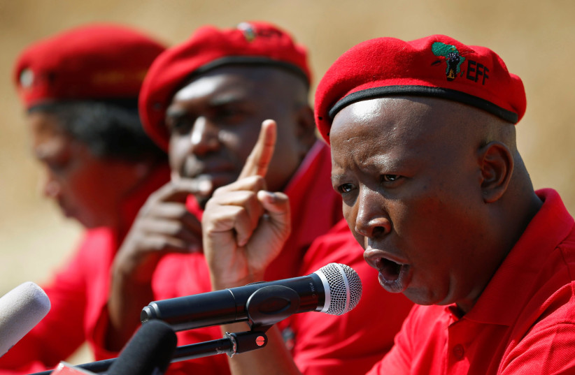 Julius Malema, leader of South Africa's Economic Freedom Fighters (EFF), gestures during a media briefing in Alexander township near Sandton, South Africa August 17, 2016. (photo credit: REUTERS/ SIPHIWE SIBEKO)