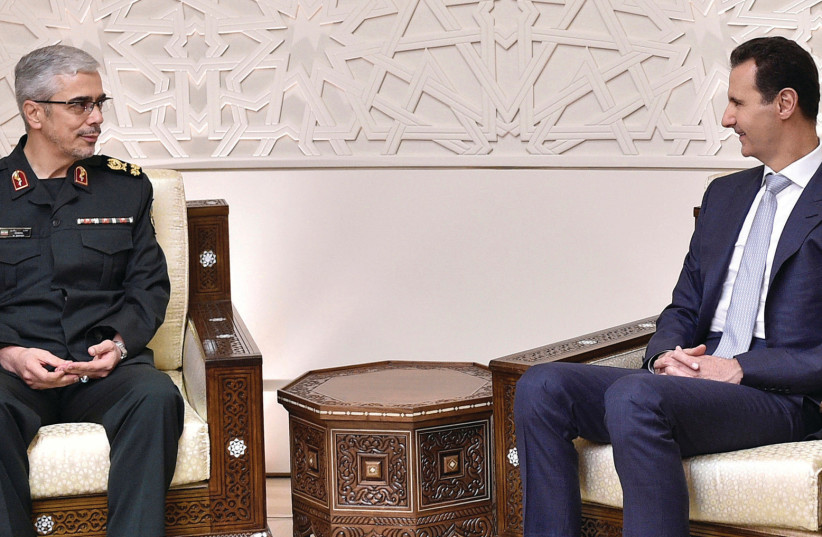 Syrian President Bashar al-Assad (right) meets Iran's military chief, Gen. Mohammed Baqeri, in Damascus, on October 19 (photo credit: SANA/REUTERS)