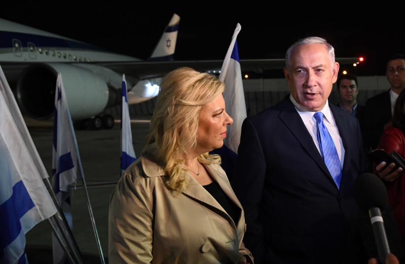 Prime Minister Benjamin Netanyahu and his wife Sara boarding a flight to London, November 1, 2017. (photo credit: GPO PHOTO DEPARTMENT)