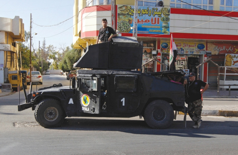 A VEHICLE of the Iraqi Federal Police is seen on a street in Kirkuk last month. (photo credit: AKO RASHEED / REUTERS)