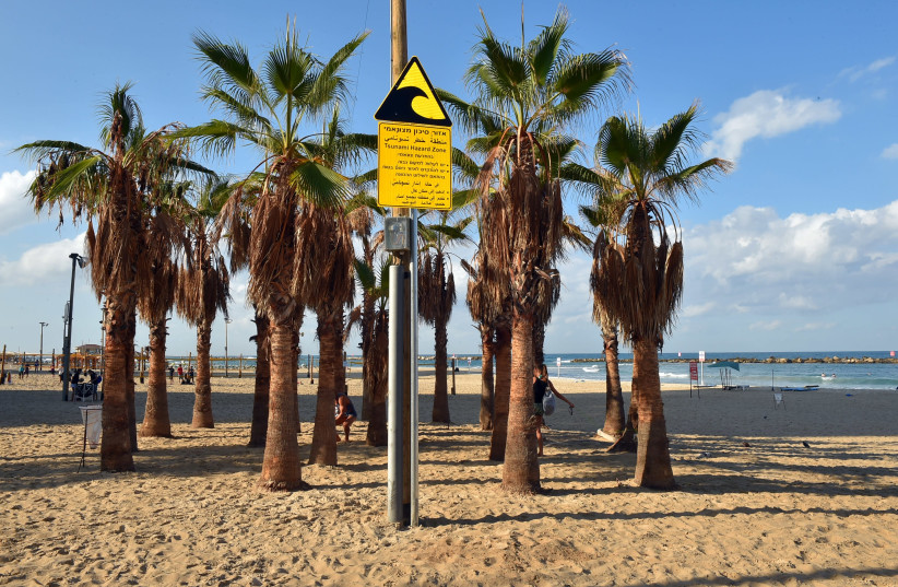 Tsunami warning sign on a Tel Aviv beach. (photo credit: ARIEL HERMONI / DEFENSE MINISTRY)