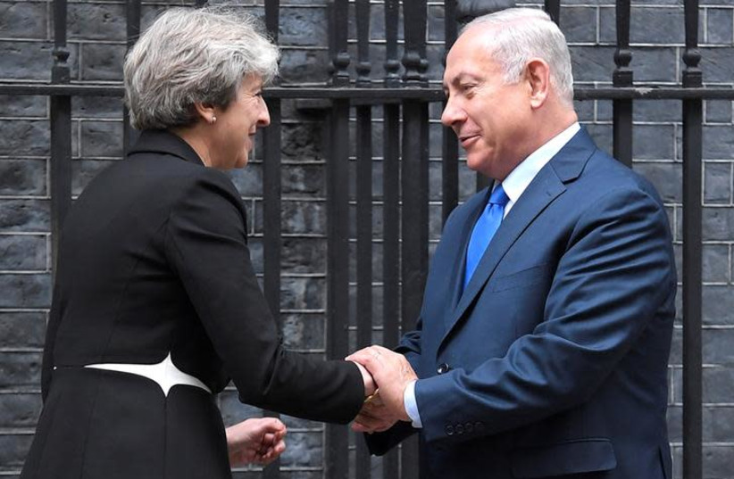 Britain's Prime Minister Theresa May welcomes Israel's Prime Minister Benjamin Netanyahu outside 10 Downing Street in London (photo credit: TOBY MELVILLE/REUTERS)