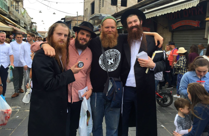 Eitan Press (center right) stands with the band Zusha and their manager. ( Zachariah Goldschmiedt, Paltiel Razenberg, Eitan Press and Shlomo Gaisin) (photo credit: ALEPH MALE)