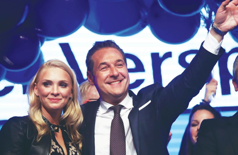 Heinz-Christian Strache, the head of the far-right Freedom Party, celebrates in Vienna with his wife, Phillipa Beck, after Austria's general election (photo credit: MICHAEL DALDER/REUTERS)