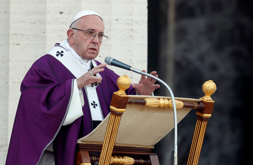 Pope Francis celebrates a Mass at the US World War II cemetery. (photo credit: REUTERS)