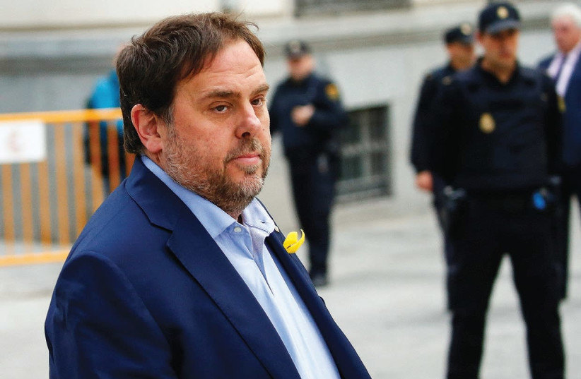 DISMISSED CATALAN vice president Oriol Junqueras arrives Thursday in Madrid to testify at Spain's High Court on charges of rebellion. (photo credit: REUTERS)
