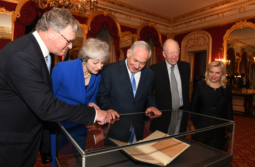 Prime Minister Benjamin Netanyahu and his wife Sara look at the original Balfour Declaration with British Prime Minister Theresa May, Lord Balfour and Lord Rothschild (photo credit: KOBI GIDEON/GPO)