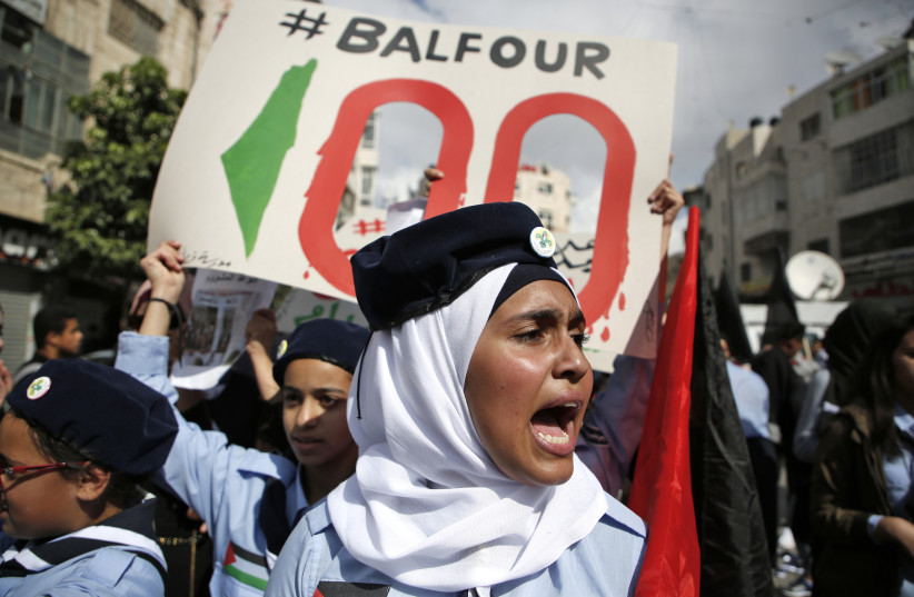 Palestinians protest the 100th anniversary of Britain's Balfour Declaration (photo credit: ABBAS MOMANI / AFP)