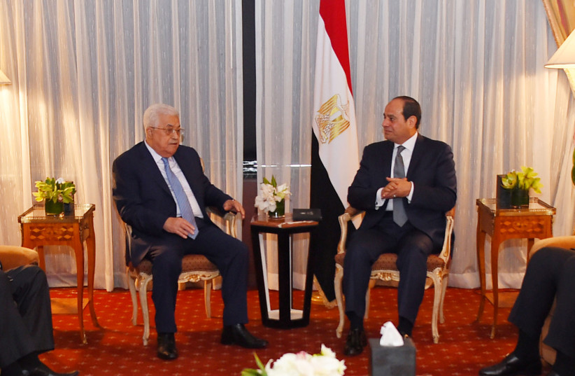 Egyptian President Abdel Fattah al-Sisi speaks with Palestinian President Mahmoud Abbas during their meeting as part of an effort to revive the Middle East peace process ahead of the United Nations General Assembly in New York, US, September 19, 2017 (photo credit: THE EGYPTIAN PRESIDENCY/HANDOUT VIA REUTERS)
