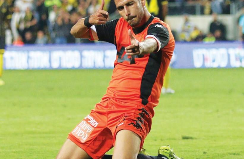 B'nei Yehuda forward Almog Buzaglo celebrates his first of two goals in a match against Beitar Jerusalem (photo credit: ADI AVISHAI)