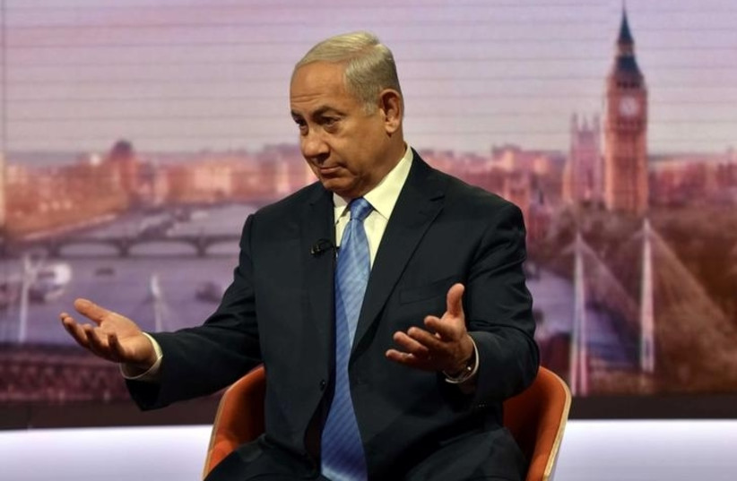Prime Minister Benjamin Netanyahu is seen speaking on the BBC's Andrew Marr Show in this photograph received via the BBC in London, Britain November 5, 2017. (photo credit: JEFF OVERS/BBC/HANDOUT VIA REUTERS)
