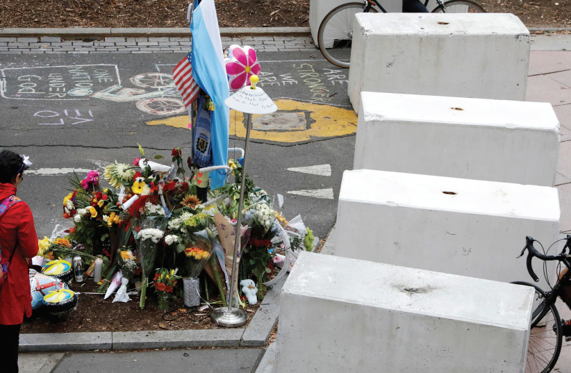 PROTECTIVE BARRIERS are placed along a bike path near a memorial to remember the victims of the New York October 31 attack, in New York City. (photo credit: REUTERS)