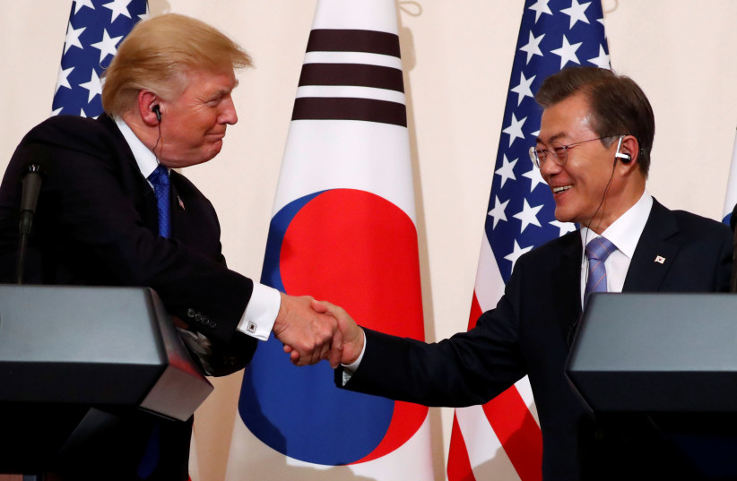 Trump meets with South Korean president Moon Jae-in on second stop of his five-country trip to Asia (photo credit: JONATHAN ERNST / REUTERS)
