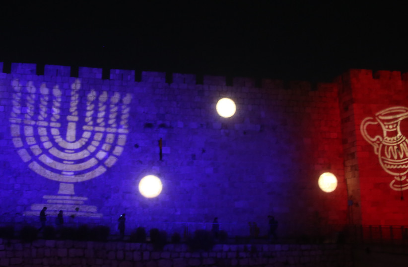 Hanukkah images are displayed on the walls of the Old City in Jerusalem (photo credit: MARC ISRAEL SELLEM)