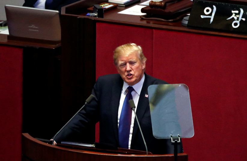 US President Donald Trump speaks at the South Korean National Assembly in Seoul, South Korea, November 8, 2017 (photo credit: REUTERS / JONATHAN ERNST)