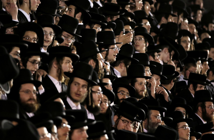 Orthodox Jews of the Satmar Hasidim celebrate the Jewish holiday of Lag Ba'Omer in the village of Kiryas Joel, New York (photo credit: MIKE SEGAR / REUTERS)