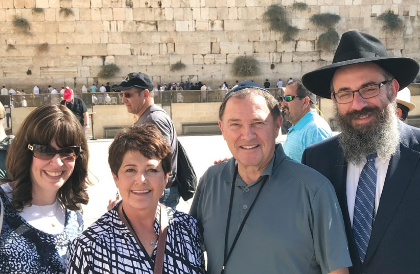 During a recent trade mission, Rabbi Benny Zippel (right), his wife Sharonne (left), Utah Governer Gary Herbert and his wife, Jeannette, visit the Kotel. (photo credit: Courtesy)