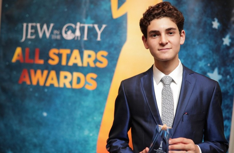 David Mazouz receives an award at Jew in the City's 2017 Orthodox All Stars event. (photo credit: DAVID MILLER)