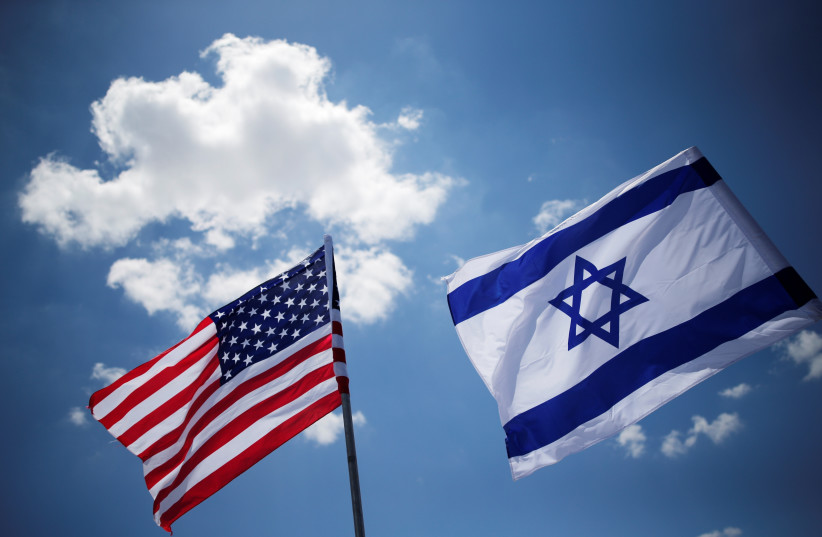 American and Israeli flags (photo credit: AMIR COHEN - REUTERS)