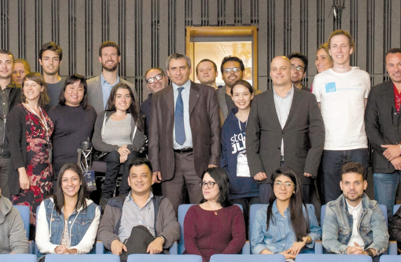 JERUSALEM AFFAIRS Minister Ze'ev Elkin (center) poses with entrepreneurs visiting the city, who were invited after winning local competitions set up by Israeli missions worldwide. (photo credit: COURTESY ELAD BRAMI/JDA)