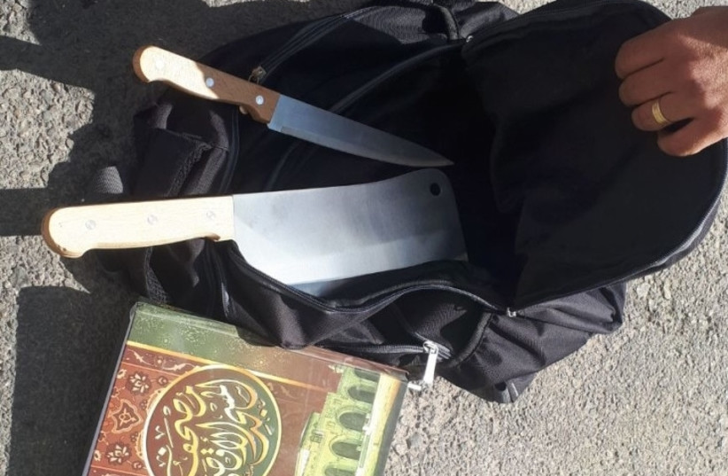 The bag containing the two knives found on the suspected terrorist at the entrance to the West Bank settlement of Kokhav Yaákov on November 9, 2017.  (photo credit: POLICE SPOKESPERSON'S UNIT)
