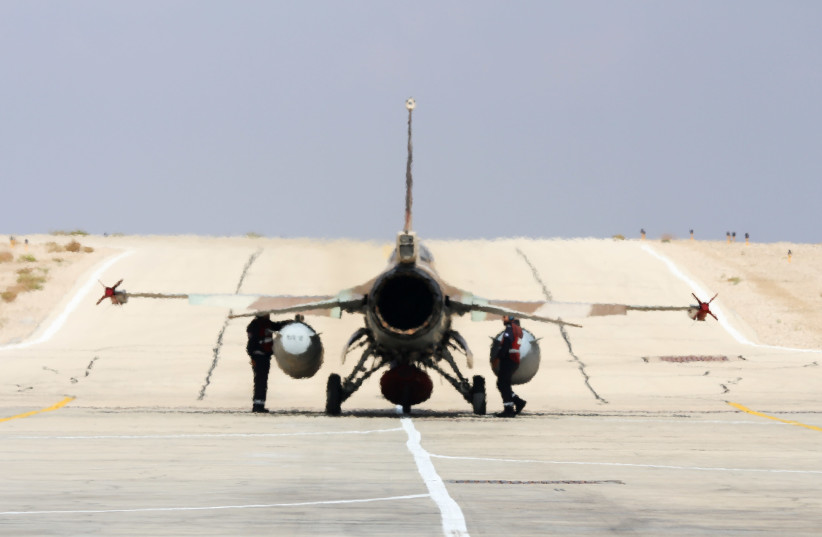 Israeli F16 belonging to Squadron 115, the Flying Dragon (Red Squadron) taxis to runway at Uvda airbase (photo credit: ANNA AHRONHEIM)