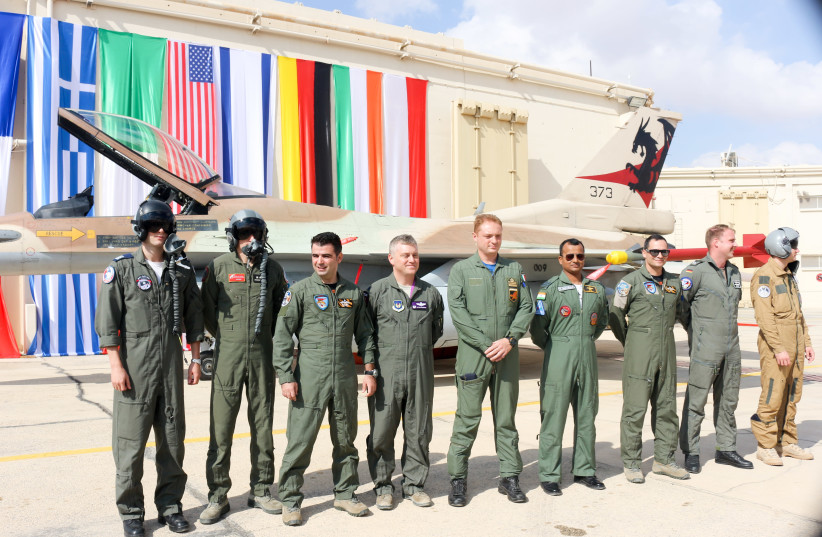 Representatives Israel, France, Greece, United States, Italy, India, Germany and Poland stand in front of an Israeli F16 (photo credit: ANNA AHRONHEIM)