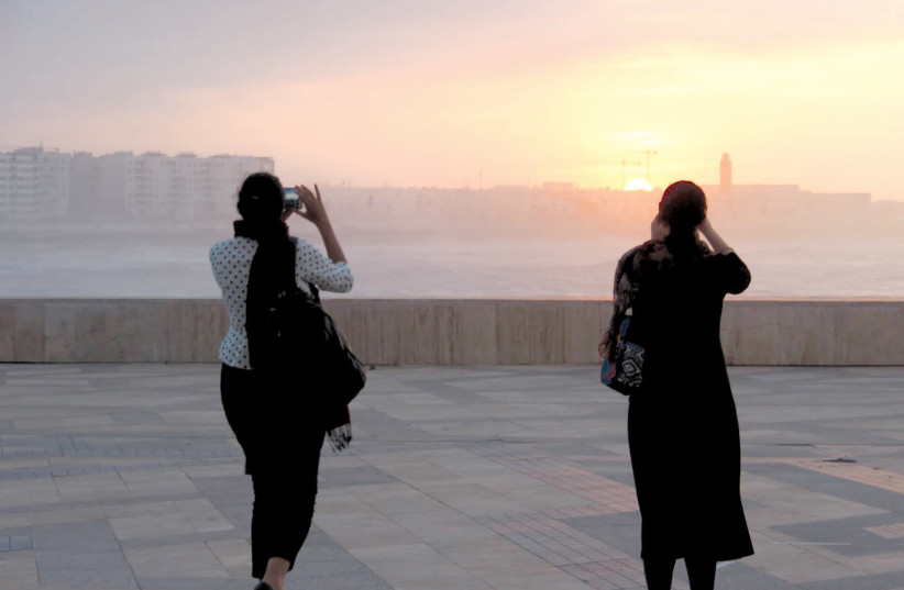 The writer and a member of the AJC delegation take a picture of the Casablanca sunset. (photo credit: NOA AMOUYAL)