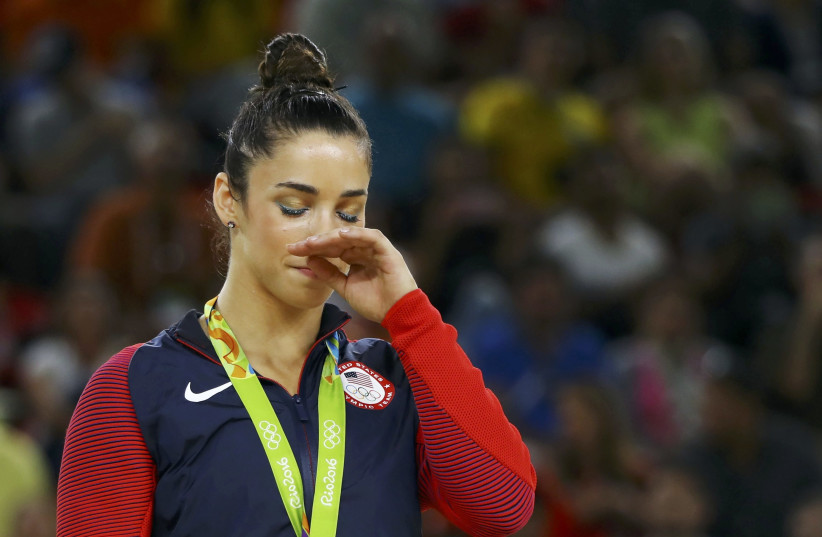 Aly Raisman receives a silver medal at the 2016 Olympics in Rio de Janeiro, Brazil. (photo credit: REUTERS)