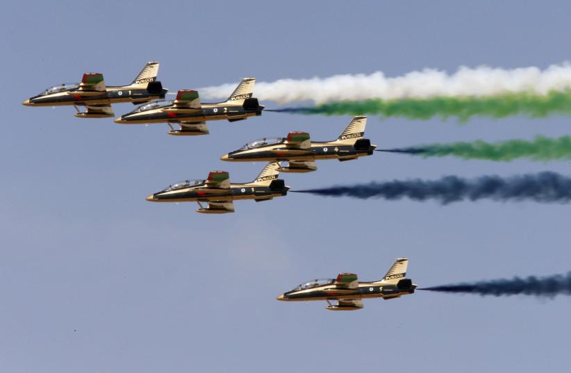 Al Fursan, the UAE Air Force performs during Dubai Airshow. (photo credit: AHMED JADALLAH / REUTERS)