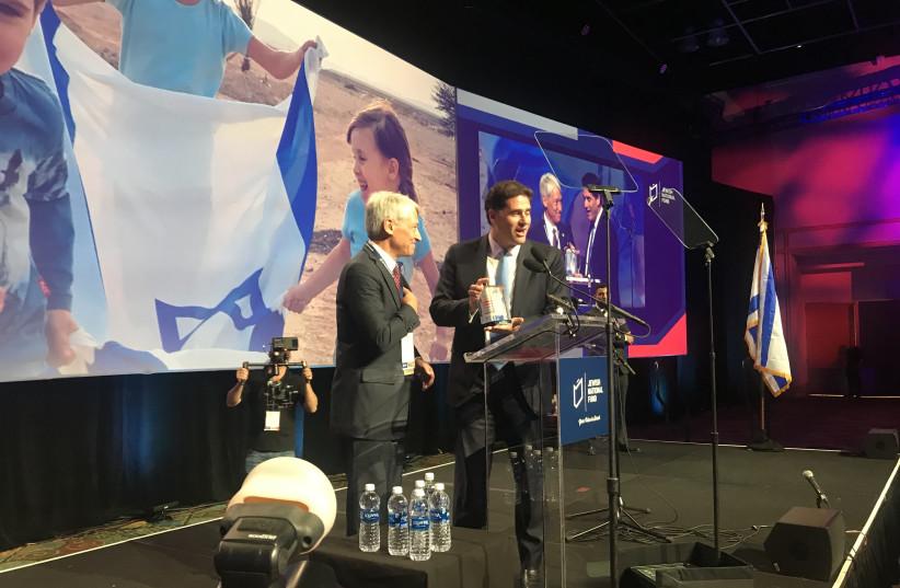 Joe Wolfson presents Ambassador Ron Dermer with a Jewish National Fund Blue Box  (photo credit: PR)
