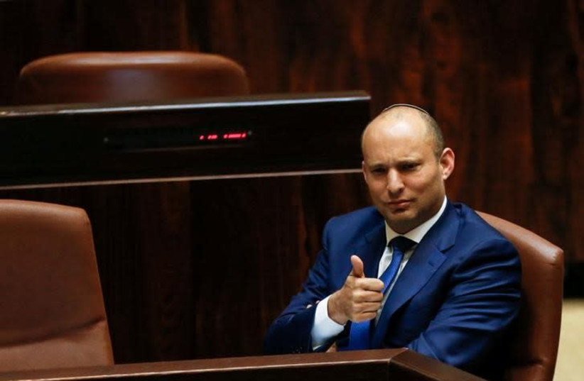 Israeli Education Minister Naftali Bennett gestures during a preliminary vote on a bill at the Knesset, the Israeli parliament, in Jerusalem November 16, 2016 (photo credit: REUTERS/AMMAR AWAD)