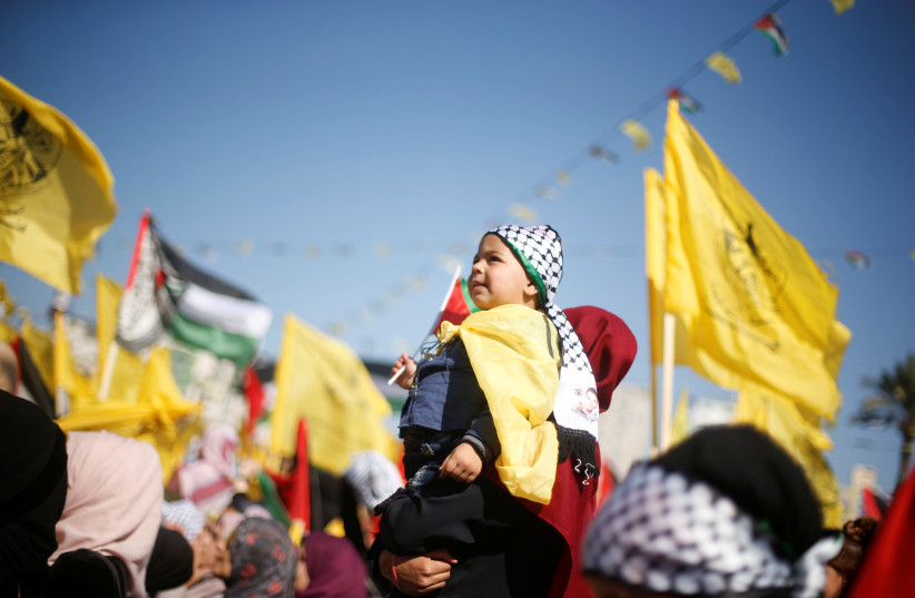 Fatah supporters take part in a rally marking the death anniversary of late Palestinian leader Yasser Arafat, in Gaza City November 11, 2017. (photo credit: REUTERS/MOHAMMED SALEM)