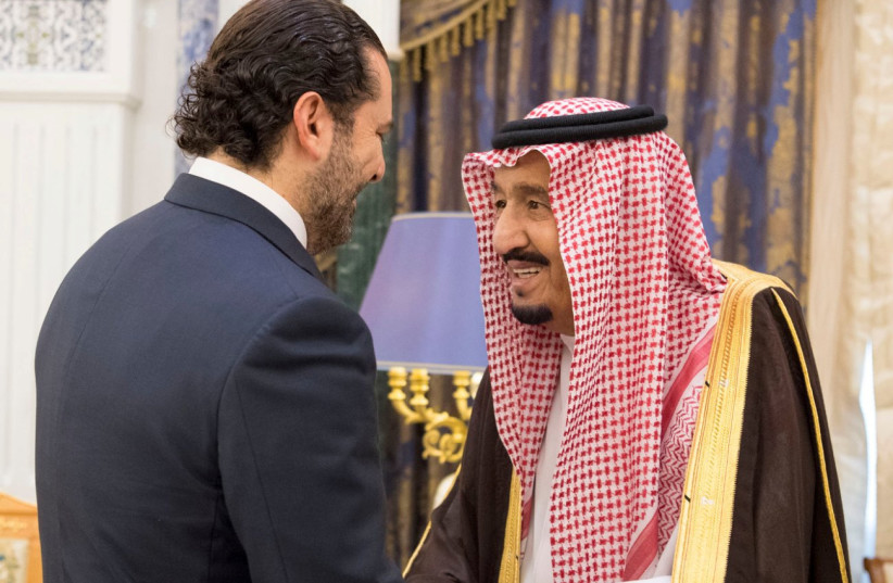 Saudi Arabia's King Salman bin Abdulaziz Al Saud shakes hands with former Lebanese Prime Minister Saad al-Hariri during their meeting in Riyadh (photo credit: SAUDI PRESS AGENCY/HANDOUT VIA REUTERS)