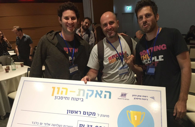 HiBob engineers Lior Harel, Doron Cyngiser and Omri Hecht win the gold at the Tel Aviv Stock Exchange's Pension and Insurance Hackathon. (photo credit: TASE)
