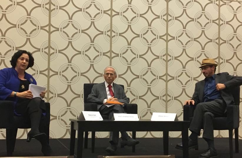 Moderator Rebecca Caspi speaks to Jonathan Sarna and Shmuel Rosner at the JFNA 2017 General Assembly (photo credit: KELLY HARTOG)
