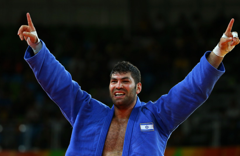 Israeli Judoka Or Sasson celebrates a win (photo credit: REUTERS/MURAD SEZER)