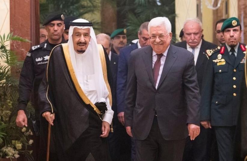 Saudi Arabia's King Salman bin Abdulaziz Al Saud walks with Palestinian President Mahmoud Abbas during a reception ceremony in Riyadh, Saudi Arabia November 7, 2017 (photo credit: SAUDI PRESS AGENCY/HANDOUT VIA REUTERS)