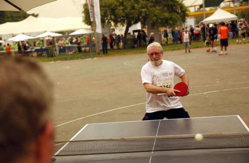 Senior Israelis play table tennis as they take part in games for people over 65 years old, organized by a nursing home in Tel Aviv (photo credit: BAZ RATNER/REUTERS)