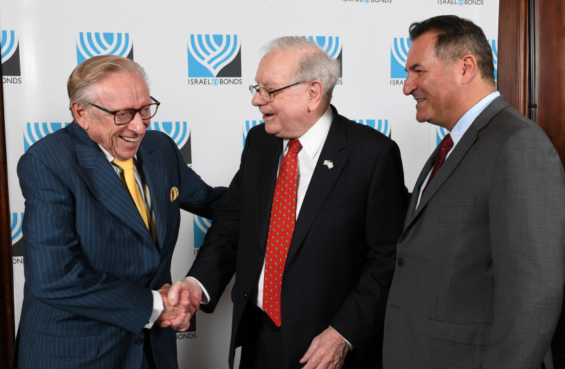 Israel Maimon (right) with famed investor Warren Buffett and prominent real estate developer Larry Silverstein at a June 2017 Israel Bonds event in New York (photo credit: SHAHAR AZRAN)