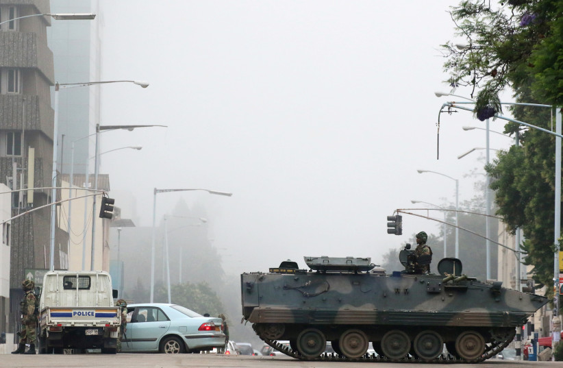 Military vehicles and soldiers patrol the streets in Harare, November 15, 2017. (photo credit: REUTERS)